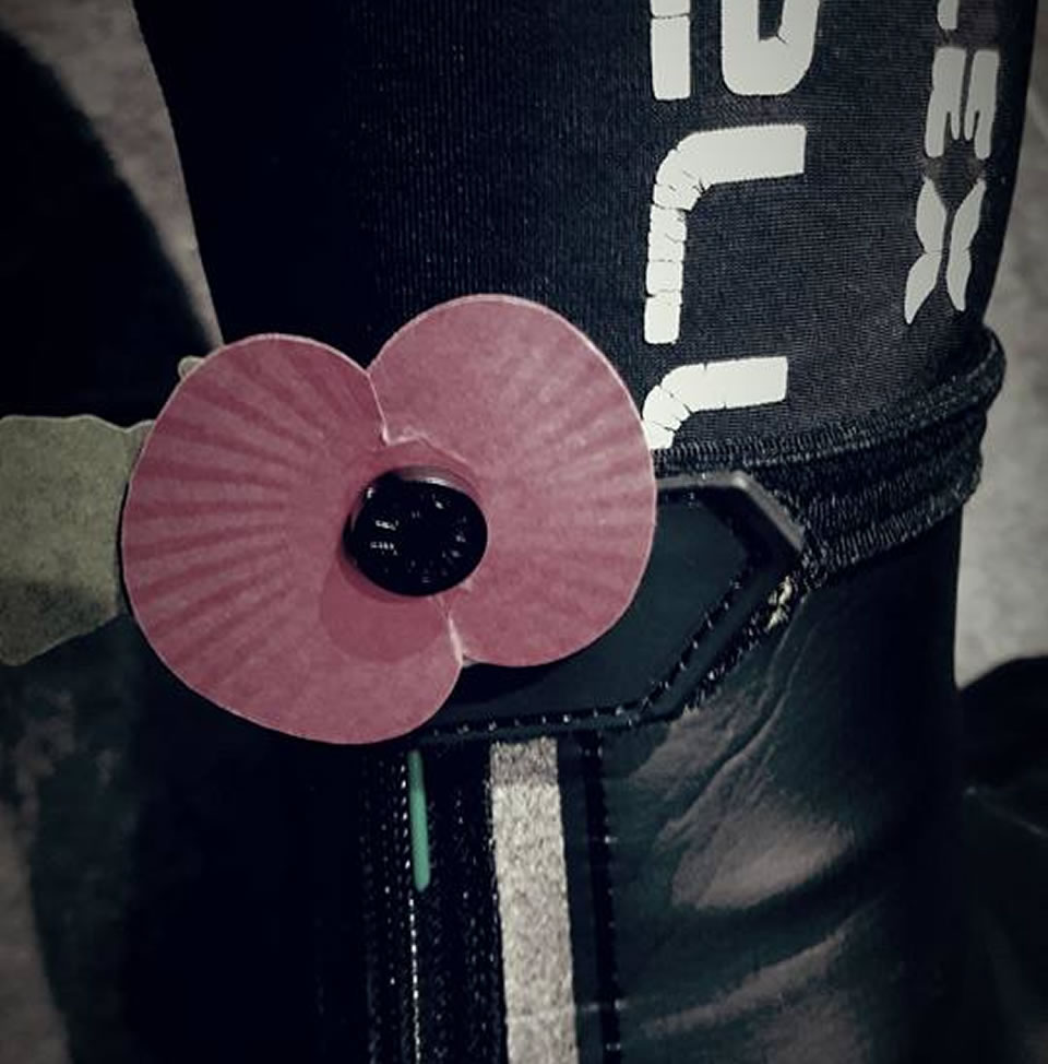 red poppy attached cyclist leg
